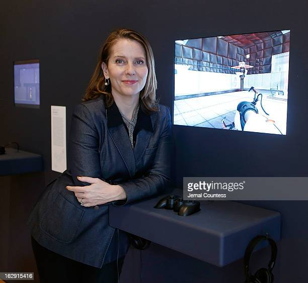 Senior curator at the Museum of Modern Art and exhibit organizer Paola Antonelli stands by one of the 14 video games that are part of the exhibiton...