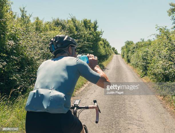 Senior Cyclist drinking from bidon