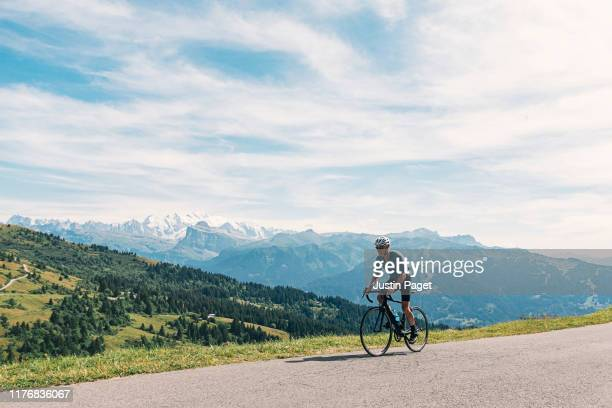 senior cyclist on the top of the col de joux plane - mountain pass stock pictures, royalty-free photos & images