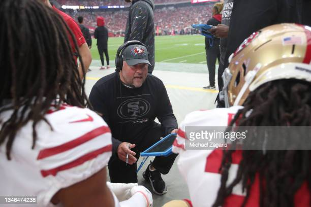 Senior Defensive Assistant/Run Game Specialsiy James Bettcher of the San Francisco 49ers talks with the linebackers on the sidelines during the game...