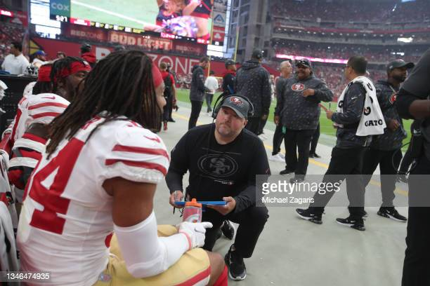 Senior Defensive Assistant/Run Game Specialsiy James Bettcher of the San Francisco 49ers talks with Fred Warner on the sidelines during the game...