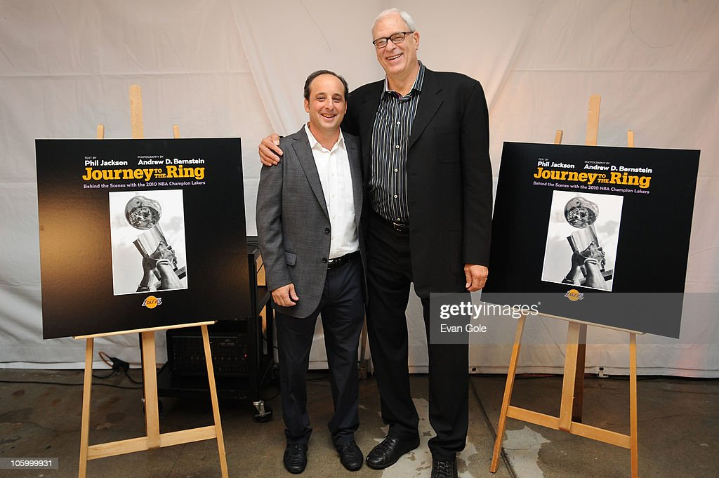 Senior Director of NBA Photos Andrew D. Bernstein and Head Coach Phil Jackson of the Los Angeles Lakers pose for a picture during the launch party for the new book Journey to the Ring with text by Los Angeles Lakers Head Coach Phil Jackson and photography by Senior Director of NBA Photos Andrew D. Bernstein at the California Yacht Club on October 24, 2010 in Marina del Rey, California.