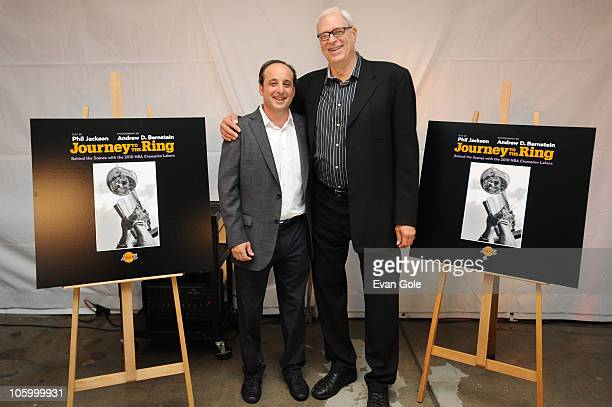 Senior Director of NBA Photos Andrew D Bernstein and Head Coach Phil Jackson of the Los Angeles Lakers pose for a picture during the launch party for...