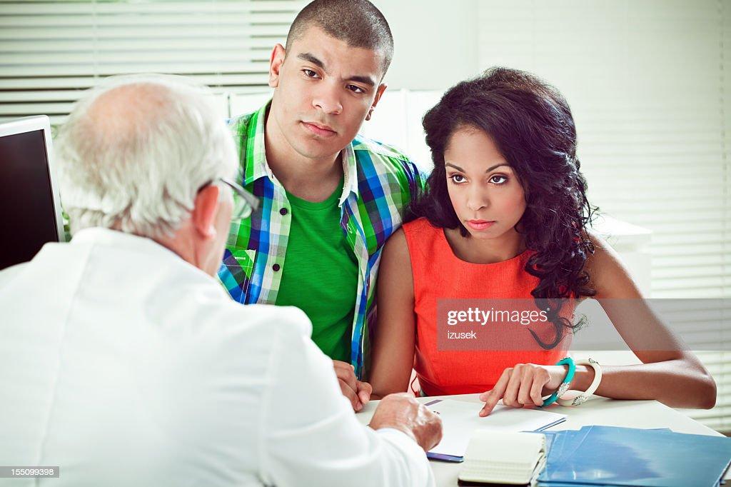 Senior doctor explaining medical results : Stock Photo