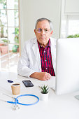 senior doctor man at clinic concentrated
