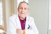 senior doctor man wearing medical coat