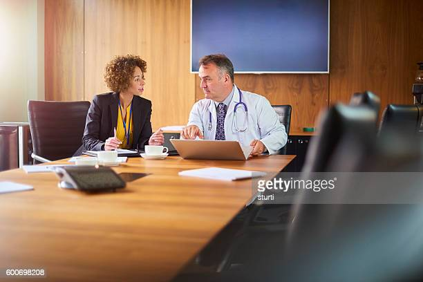 senior doctor with administrator