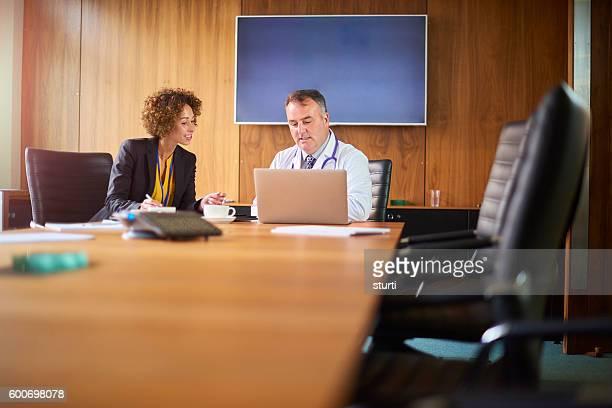 senior doctor with salesperson