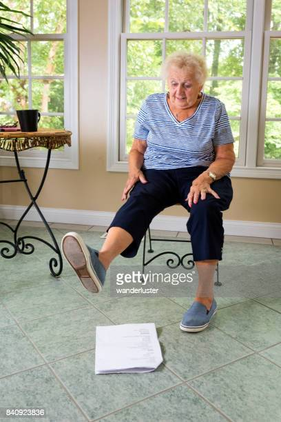 Senior doing physical therapy exercises at home