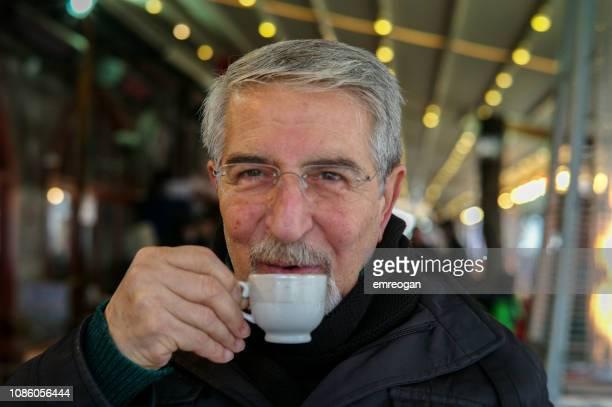 Senior drinking coffee