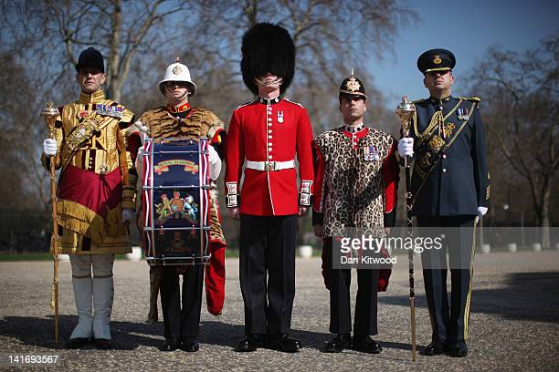 Senior Drum Major Betts of the Scotts Guard Bugler Lee Kidd Guardsman Adam Deer of the Coldstream Guards and Lance corporal Michael Strong of the...