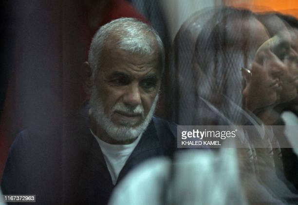 Senior Egyptian Muslim Brotherhood member Sobhi Saleh is seen behind bars during a verdict and sentencing session of a retrial for him and other...