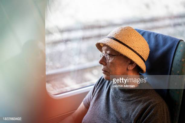 senior elderly woman traveling on train - train interior stock pictures, royalty-free photos & images
