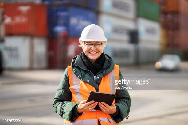 senior engineer at container warehouse - health and safety stock pictures, royalty-free photos & images