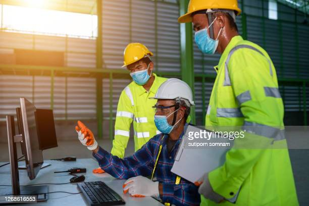 senior engineering working training team for young engineering in the office with the computer for using design - 578105427 stock pictures, royalty-free photos & images