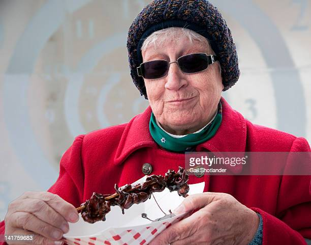 senior enjoys chocolate covered bacon - ontario canada stock pictures, royalty-free photos & images