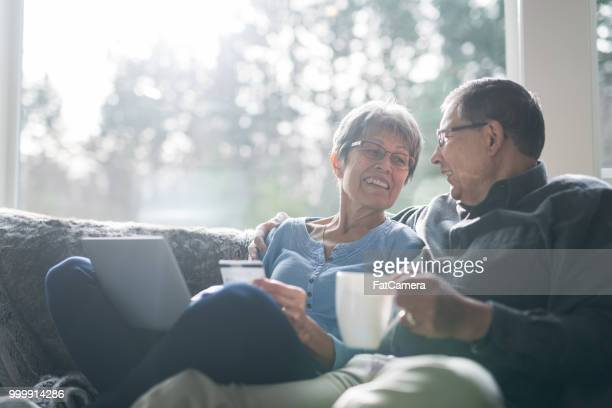 senior ethnic couple enjoying coffee together - fat granny stock pictures, royalty-free photos & images