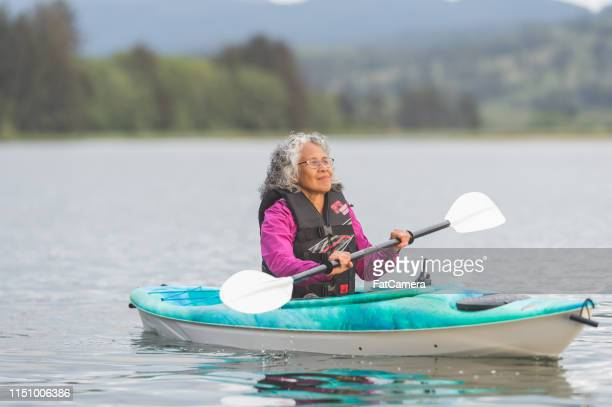 senior ethnic woman kayaking solo on the river - hot women on boats stock pictures, royalty-free photos & images