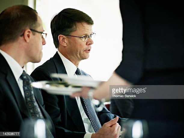 Senior executive leading meeting in restaurant