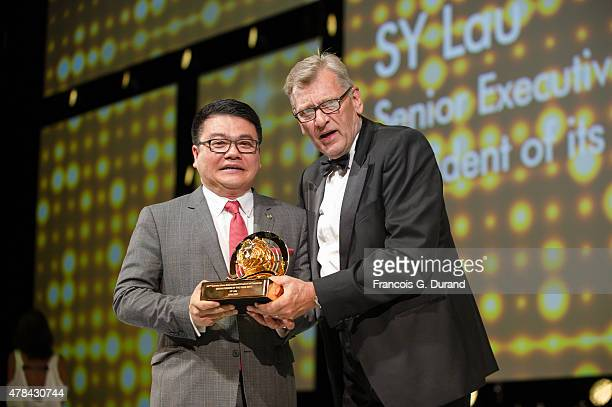 Senior Executive Vice President of Tencent and President of its Online Media Group Sy Lau receives the Media person of the year award from Chairman...
