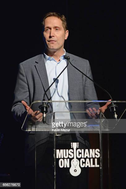 Senior Executive Vice President of the RIAA Mitch Glazier speaks onstage at A Night To Celebrate Elvis Duran presented by Musicians On Call at The...