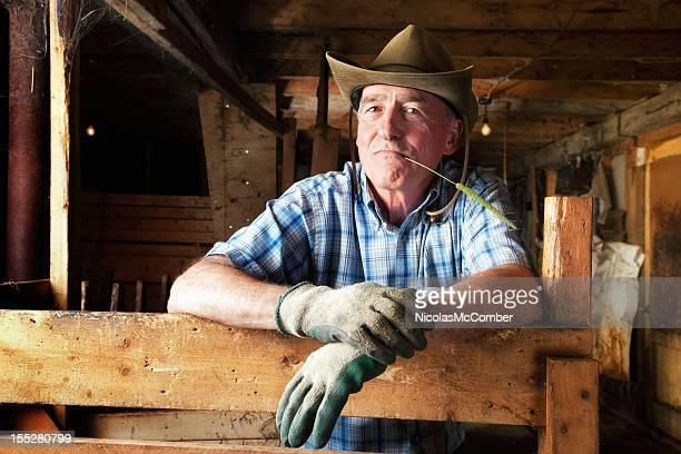 Senior farmer at rest in his barn