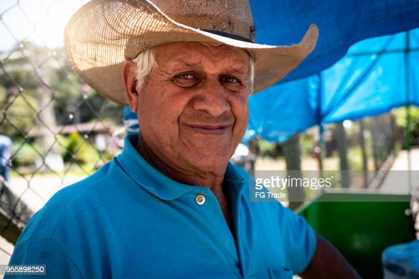 senior farmer/countryside man - mato grosso state stock pictures, royalty-free photos & images
