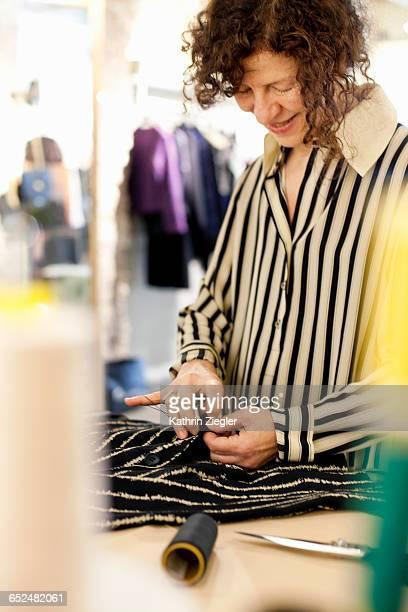 senior fashion designer sewing