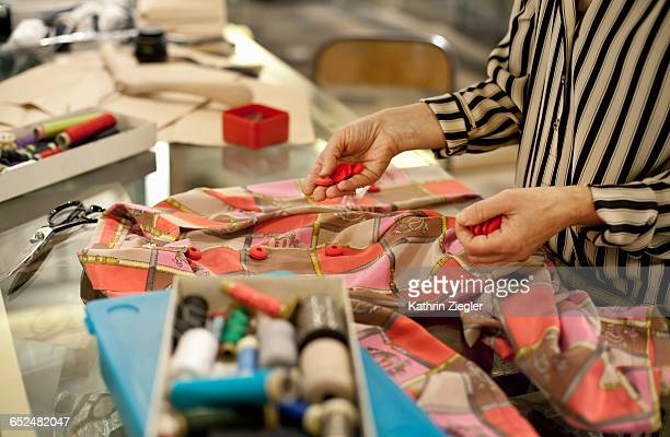 senior fashion designer working in studio - textile industry stock pictures, royalty-free photos & images