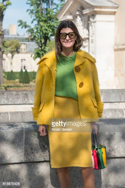 Senior Fashion Editor at Vogue Japan Giovanna Battaglia Engelbert wears a Prada jacket skirt and top Sara Battaglia bag day 4 of Paris Womens Fashion...