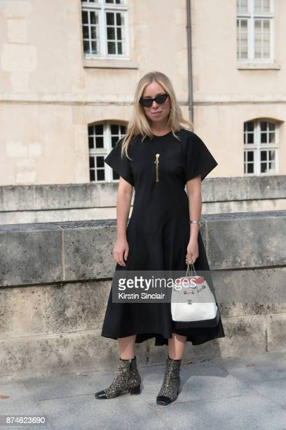 Senior Fashion Editor at W Magazine Caroline Grosso wears an Ellery dress Celine earrings Chanel bag and boots and Le Specs x Adam Selman sunglasses...