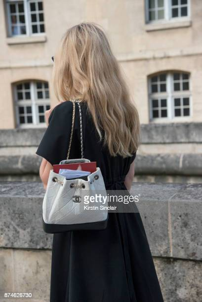 Senior Fashion Editor at W Magazine Caroline Grosso wears an Ellery dress and a Chanel bag day 4 of Paris Womens Fashion Week Spring/Summer 2018 on...