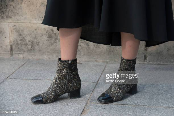 Senior Fashion Editor at W Magazine Caroline Grosso wears Chanel boots day 4 of Paris Womens Fashion Week Spring/Summer 2018 on September 29 2017 in...