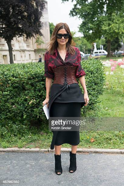 Senior Fashion Editor for Vogue Australia Christine Centenera wearing a Prada top Celine skirt and sunglasses and Tom Ford shoes day 3 of Paris Haute...