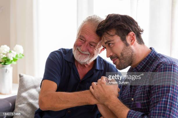 senior father adult son playing together