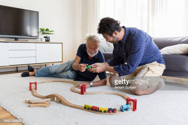 senior father adult son playing with