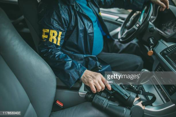 senior fbi agent in action - criminal investigation stock pictures, royalty-free photos & images