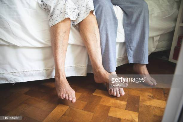 senior feet close up waking up - old man feet stock pictures, royalty-free photos & images