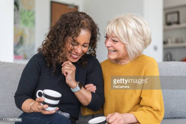 senior female friends having tea - independence stock pictures, royalty-free photos & images