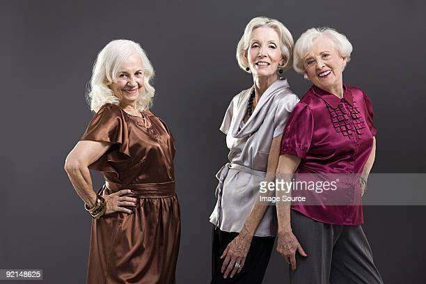 senior female friends - grey dress stock pictures, royalty-free photos & images