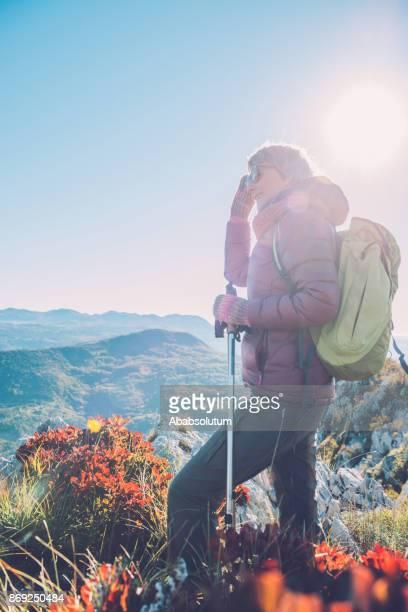 Senior Female Hiker Enjoying the View at Dawn in Autumn, Southern Julian Alps, Europe