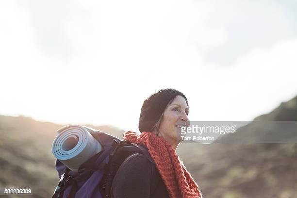Senior female hiker with rucksack on
