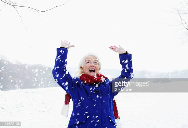 A senior female in the snow