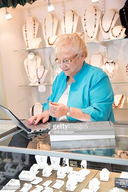Senior female Jewelry store owner working in her store