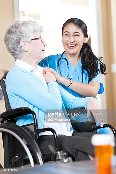 Senior female patient talks with nurse during home visit