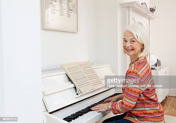 A senior female playing the piano