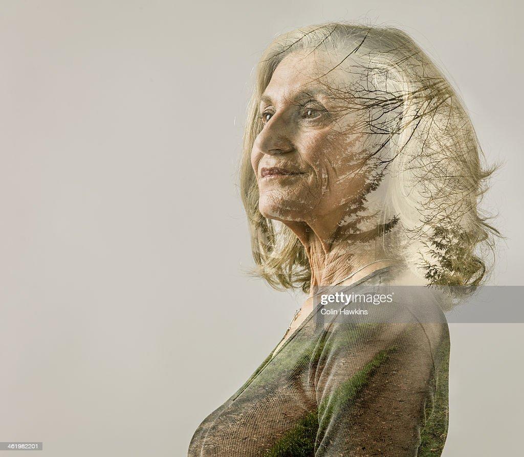 Senior female portrait with rural track overlay : Stock-Foto