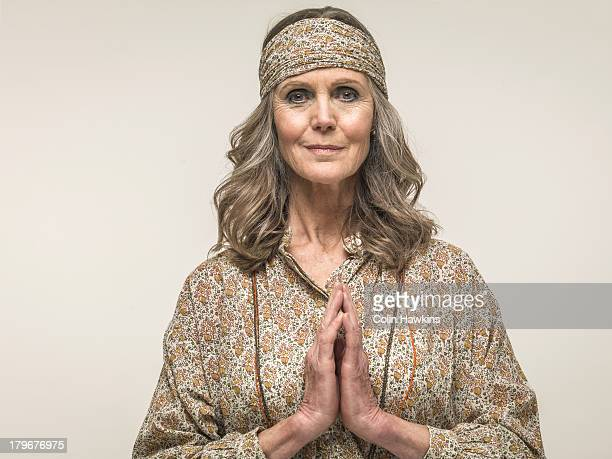 senior female praying - colin hawkins stock pictures, royalty-free photos & images