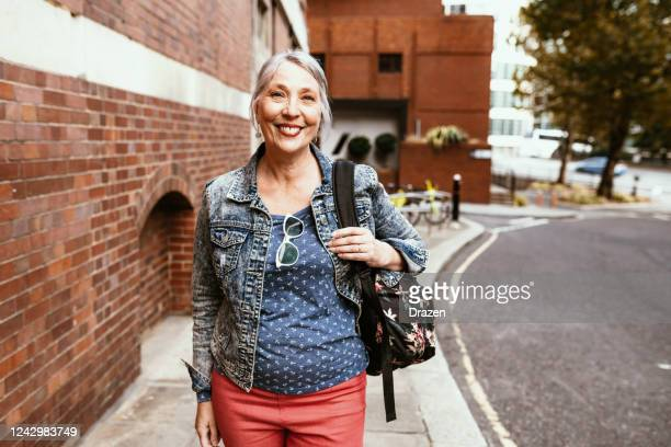 senior female tourist in london - active seniors stock pictures, royalty-free photos & images
