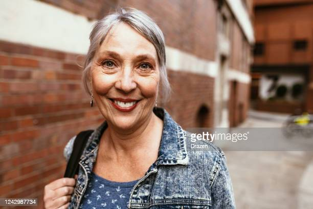 senior female tourist in london, traveling after coronavirus pandemic - northern european descent stock pictures, royalty-free photos & images